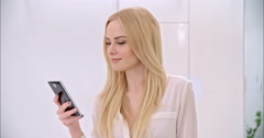 Young Blond Girl Using Mobile Phone Arkistovideo