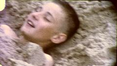 Boy Buried in the Sand AT BEACH 1960s Vintage Retro Film Home Movie 8088 Stock Footage