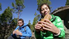 Eating hiking people taking break enjoying food on hike Stock Footage