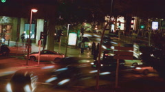 Night City Cars Moving and People Walking Time Lapse Stock Footage