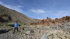 Hiking man walking volcano Teide on Tenerife - Hiker trekking on trail Stock Footage
