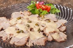 Italian vitello tonnato on a glass plate Stock Photos