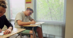 Students doing their school assignments and homework in class. Ultra HD 4K - stock footage