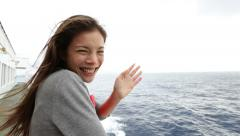 Cruise ship woman on boat waving hand saying hello  travel sailing on sea - stock footage