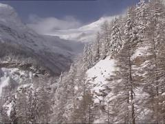 Vehicle shot - view from riding train at rough mountain scenery in winter Stock Footage