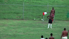 Jamaica Montego Bay Caribbean Sea 040 native citizens play soccer Stock Footage