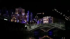 Romantic boat trip under bridges in festive Ljubljana city Stock Footage
