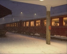 Train at ST. MORITZ railway station waiting to depart in snowstorm Stock Footage
