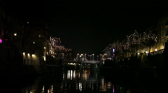 Romantic boat trip under bridges in festive Ljubljana city - stock footage