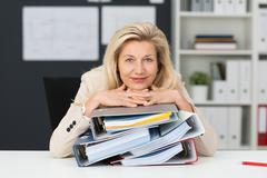 Contented middle-aged businesswoman Stock Photos