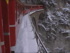Stock Video Footage of Vehicle shot Passenger train Glacier Express crossing the Landwasser Viaduct