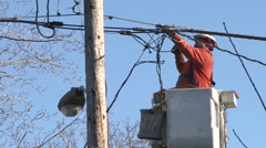 Electrician Working On Power Lines Stock Footage