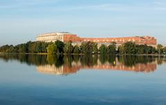 The congress hall reflected in still lake in nuremberg Stock Photos