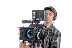 young cameraman with movie camera - stock photo