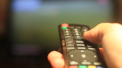 TV Remote Control Surfing television channels Stock Footage