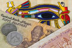 Typical egyptian papyrus and different banknotes Stock Photos