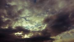 4K timelapse morning dramatic heavy dark clouds overhead Stock Footage