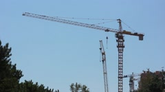 Tower cranes on construction site Stock Footage