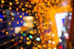 Defocus blurred orange bokeh background Stock Photos