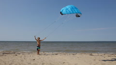 Boy practice kitesurf Stock Footage