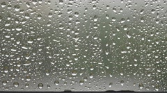 Glass window with raindrops Stock Footage