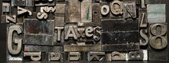 Metal type printing press typeset obsolete typography text letters taxes Stock Photos