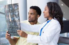 Closeup portrait of intellectual healthcare professionals with white labcoat, Stock Photos