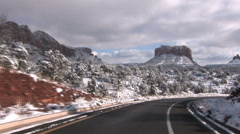 Driving forward into Sedona Red Rocks in Snow Stock Footage