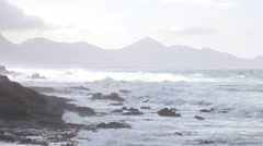 Storm waves on the rocky shore Stock Footage