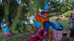 Band full of children on a outdoor party Stock Footage