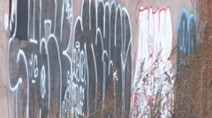 Gang graffiti in a Detroit neighborhood - stock footage