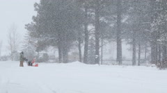Man using Snowblower in a Blizzard 4K Stock Footage