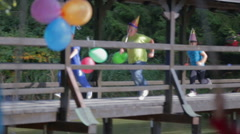 Kids running over the wooden bridge  Stock Footage