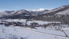 Stock Video Footage of Aerial - Panorama of rural mountain region landscape covered in snow