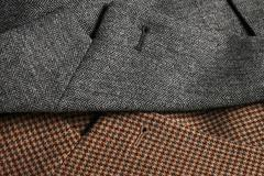 Lapels of a gray and brown classic tweed coats Stock Photos
