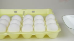 Picking an egg carton Stock Footage
