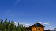 Clouds and Blue Sky Over British Columbia Cabin Time Lapse Stock Footage