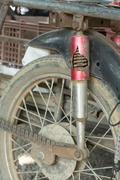 Motorcycle shock absorber rusty crack broken Stock Photos