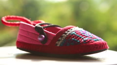 One knitted baby shoes with embroidered national Stock Footage