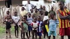 Africa village kids standing and stairing Guinea Bisseau Stock Footage