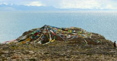 4k huge clouds mass rolling over lake namtso & snow mountain,pray flag in wind. Stock Footage