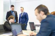 Stock Photo of Business people in modern office.