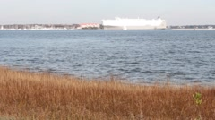 Cargo Ship in the Distance Pull From Port  Stock Footage