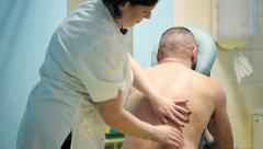 Female physiotherapist massaging patients back HD Stock Footage