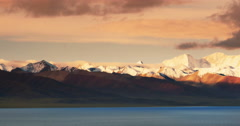 4k sunrise huge clouds mass rolling over lake namtso & snow mountain in tibet. Stock Footage