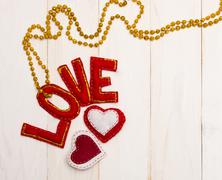 Red letters love and textile hearts. Stock Photos
