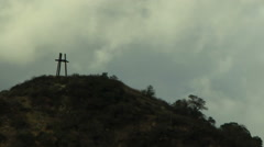 Time lapse of a Christian Holy Trinity symbol on hill against a blue cloudy sky - stock footage