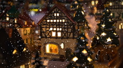 Small winter village scene with illuminated houses and snowing Stock Footage