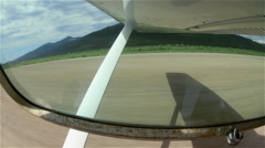 Looking Out Past Wing of Cessna 180 to Alaskan Landing Strip Stock Footage