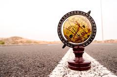 Globe earth on an asphalt street Kuvituskuvat